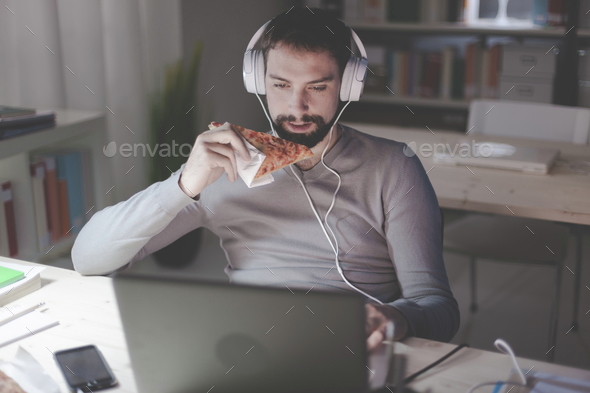 Man dining at home and networking - Stock Photo - Images