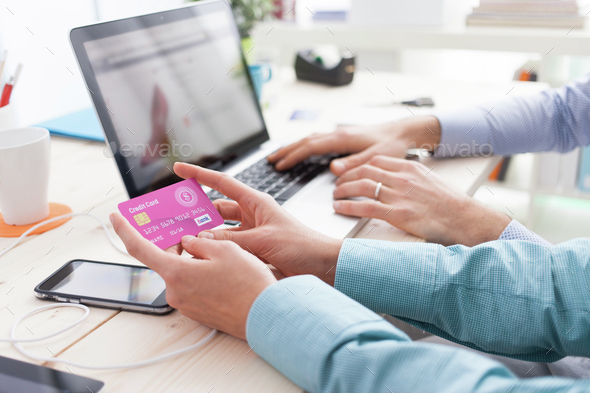 Married couple shopping online at home - Stock Photo - Images