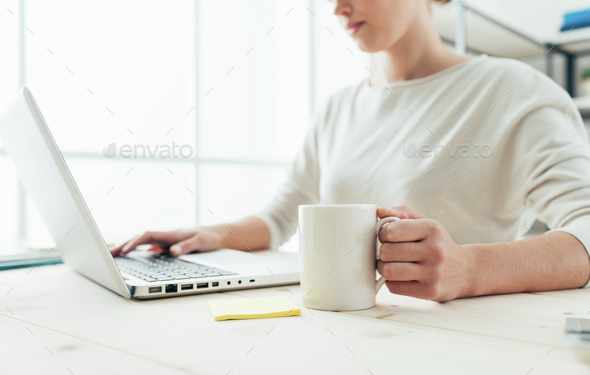 Woman having a coffee break and networking - Stock Photo - Images