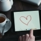 Male Hands Are Painting a Romantic Picture For His Girlfriend Using a Tablet - VideoHive Item for Sale
