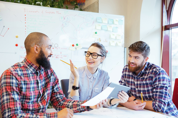 Happy business people working together - Stock Photo - Images