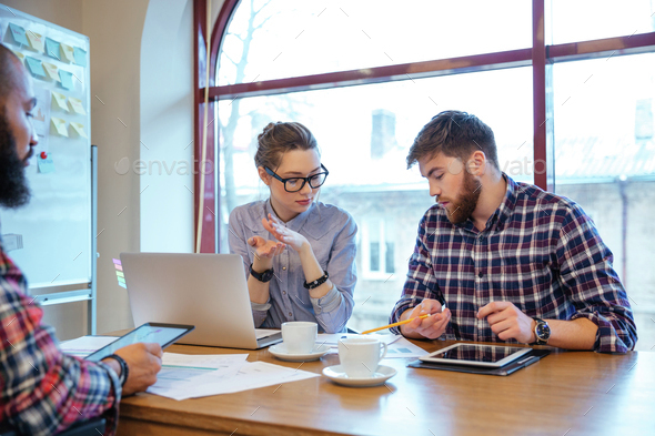 Business people having brainstorm - Stock Photo - Images