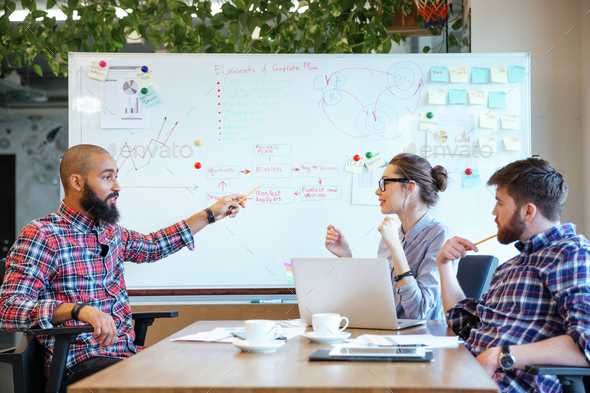 Business people working together in office - Stock Photo - Images