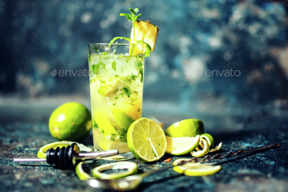 refreshment alcoholic cocktail drink at bar or pub. Gin and lime cocktail with pineapple and ice - Stock Photo - Images