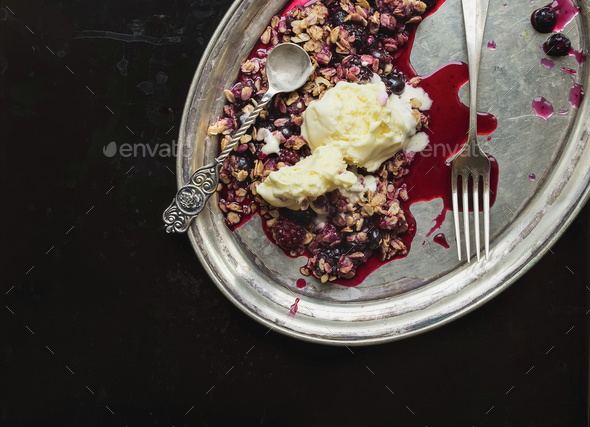 Baked oatmeal with berries and vanilla ice-cream with a tea-spoo - Stock Photo - Images