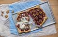 Rustic plum pie with walnuts and vanilla ice-cream