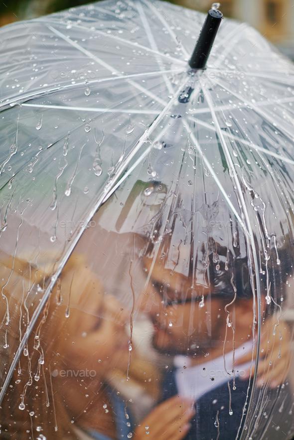 Raindrops on umbrella - Stock Photo - Images