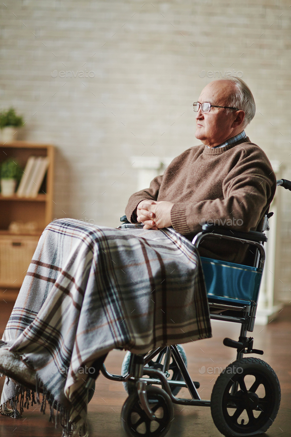Senior man on wheelchair - Stock Photo - Images