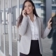 Happy Business Woman On Phone Next To Window - VideoHive Item for Sale