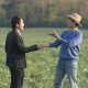 Farmer And Businessman Shaking Hands - VideoHive Item for Sale