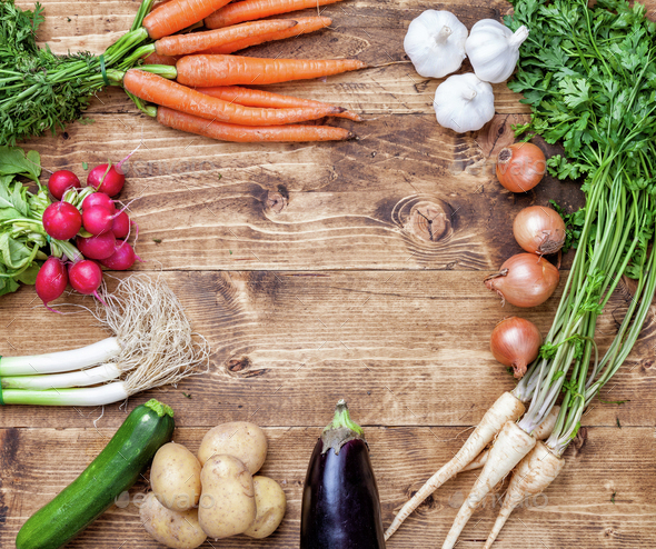 Fresh organic bio vegetables on wooden background - Stock Photo - Images