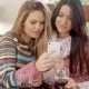 Couple Of Young Girlfriends Checking Their Phone - VideoHive Item for Sale