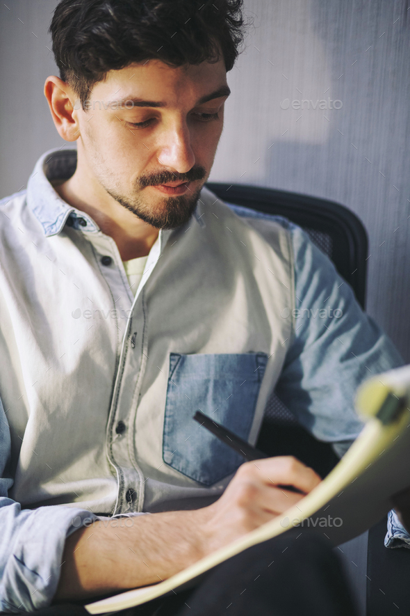 Designer at work in office - Stock Photo - Images