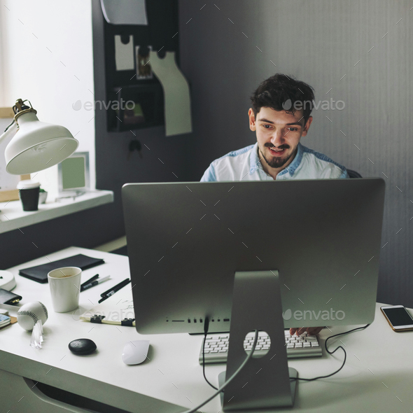 Young graphic designer working in office - Stock Photo - Images
