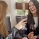 Woman Laughing With Friend Over Wine - VideoHive Item for Sale