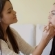 Woman Putting Make Up To Her Pretty Friend - VideoHive Item for Sale