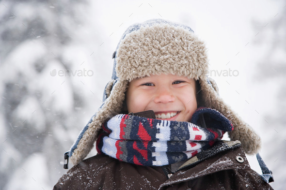 Boy in the snow - Stock Photo - Images