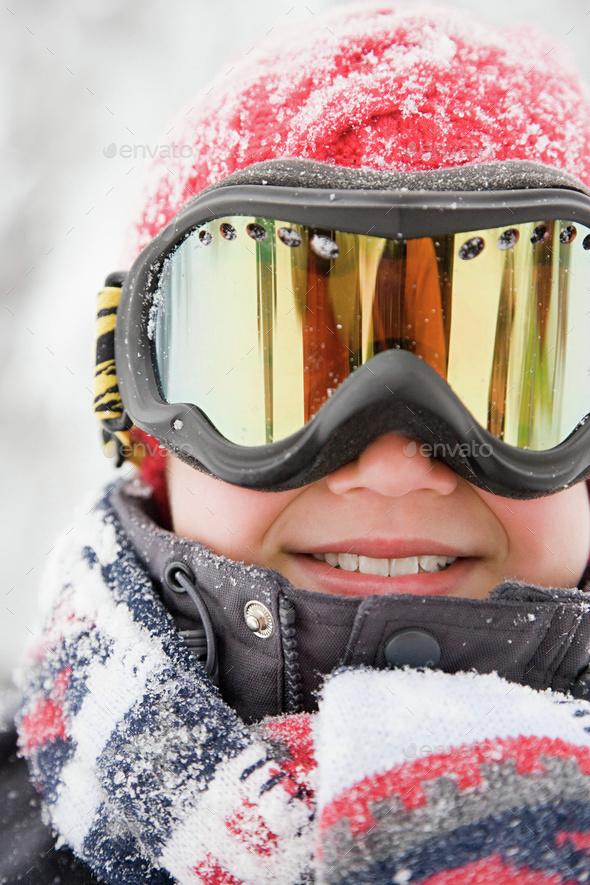 Boy wearing ski goggles - Stock Photo - Images