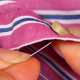 Seamstress Sewing a Button on a Shirt - VideoHive Item for Sale