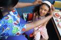 Nurse putting headband on girl - PhotoDune Item for Sale