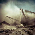 Working gravel crusher. Industrial background