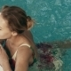 Lovely Girl Swam Over The Edge Of The Pool - VideoHive Item for Sale