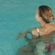 Beautiful Girl Swimming In The Pool - VideoHive Item for Sale