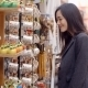 Smiling Young Woman Checking Out Shop Merchandise - VideoHive Item for Sale