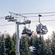 Gondolas Passing Above Snowy Trees - VideoHive Item for Sale