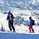 People Ski Past Mountains In The Sun - VideoHive Item for Sale