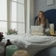 The Girl On a Bed Working With a Laptop And Breakfast - VideoHive Item for Sale