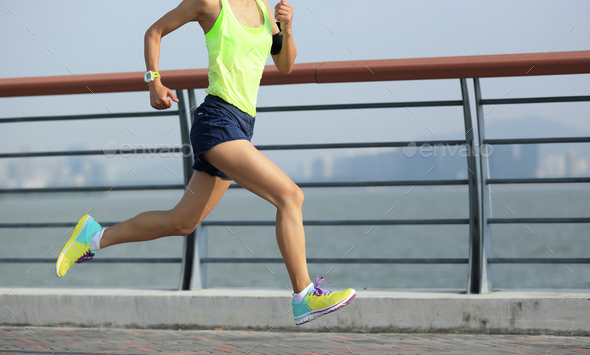 young fitness woman runner running at seaside - Stock Photo - Images