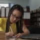 Girl With Long Hair Wearing Glasses Working In The School Library - VideoHive Item for Sale