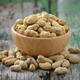 peanuts in a wood bowl on a wooden table - PhotoDune Item for Sale