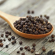 Whole black pepper on wooden spoon - PhotoDune Item for Sale