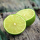 Fresh limes on wooden background - PhotoDune Item for Sale