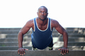 Fit handsome african american man exercise push ups