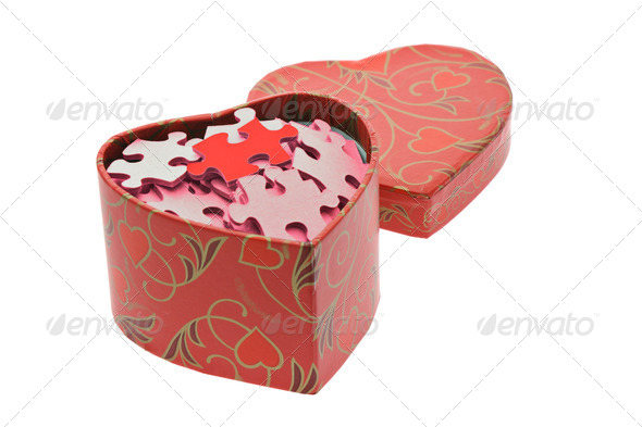 Red and pink jigsaw puzzles in heart shape gift box - Stock Photo - Images