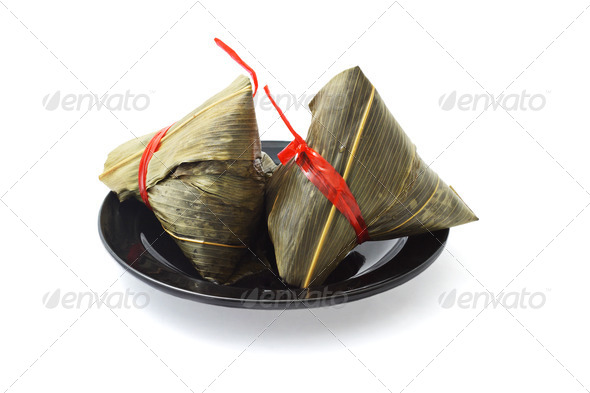 Two wrapped Chinese rice dumplings - Stock Photo - Images
