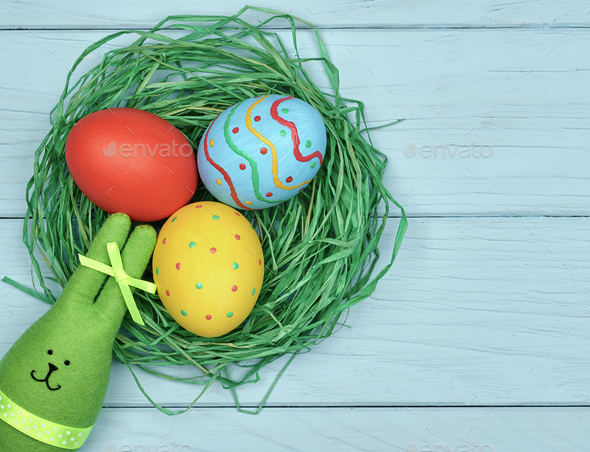 Easter eggs hand painted, rabbit, wood background - Stock Photo - Images