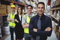 Portrait of warehouse manager and workers in warehouse - PhotoDune Item for Sale