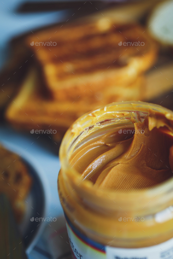 Open jar of peanut butter - Stock Photo - Images