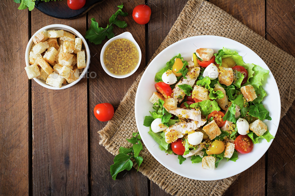 Salad with chicken, mozzarella and cherry tomatoes - Stock Photo - Images