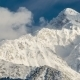 Clouds Over The Snow-capped Peaks Of The Mountains - VideoHive Item for Sale
