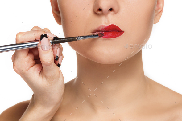 Beautiful female lips with make-up and brush - Stock Photo - Images