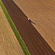 Aerial Footage of a Tractor on a Field - VideoHive Item for Sale