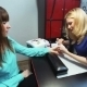 Manicurist Makes Manicure For The Girl In a Nail Salon - VideoHive Item for Sale