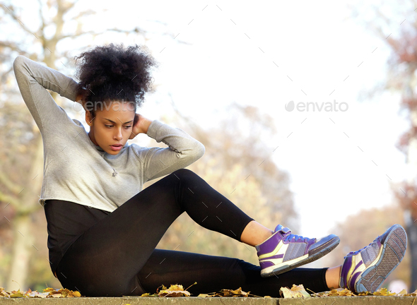 Young african american woman exercising sit ups - Stock Photo - Images