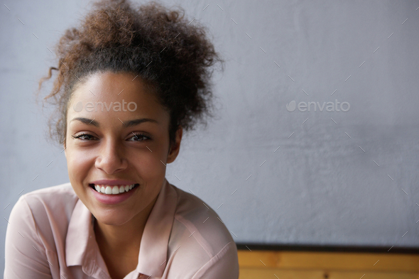 Happy young black woman smiling - Stock Photo - Images