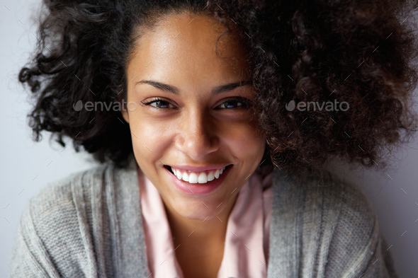 Beautiful african american woman face smiling - Stock Photo - Images